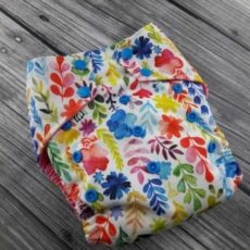 Watercolor Wildflowers Diaper on a grey wooden background